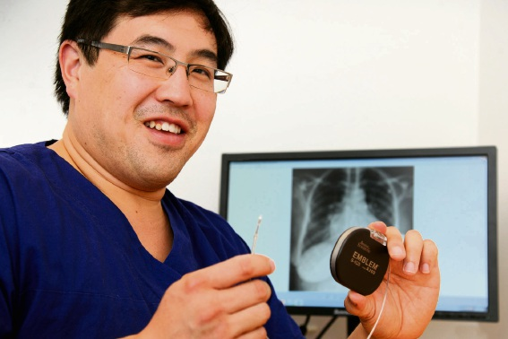 Cardiologist Justin Ng with the implantable defibrillator. Picture: Chris Kershaw.