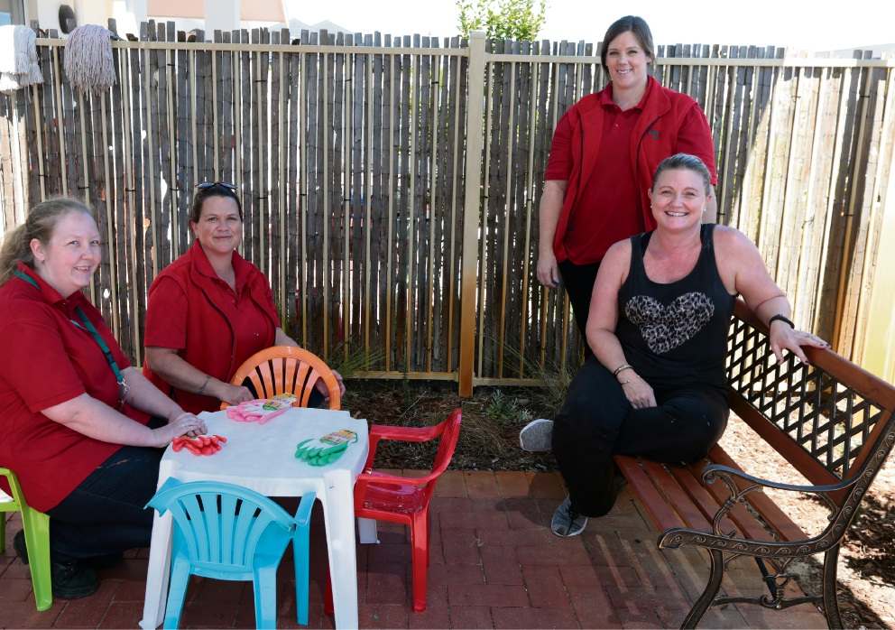 Bunnings staff Cindy Holloway, Nardia Ginn and Sharon Rice with Denise from Rebecca West House.