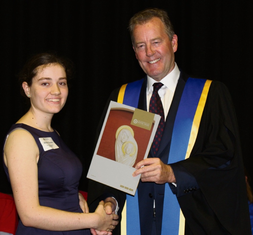 Mireille Christie receiving the Vice Chancellor's Scholarship from Notre Dame Chancellor Peter Prendiville.