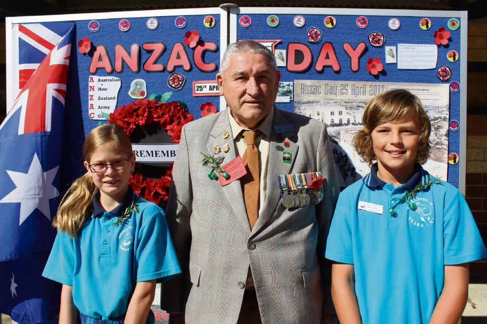 Year 6 students Madison Hunt and Bryce Illingworth with Mandurah RSL member  John Scott prepare to lay wreaths at the school Anzac assembly.  Picture: Jon Hewson         d467684