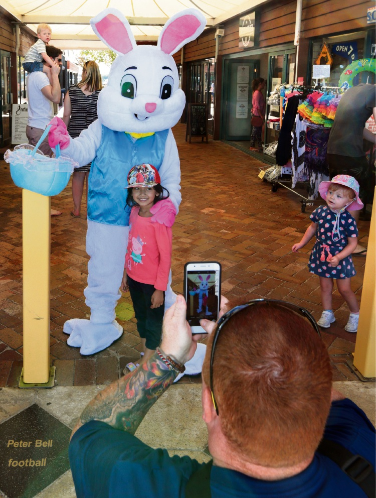 Devika Ghurkani gets a photo with the Easter Bunny. Picture: Martin Kennealey d467929