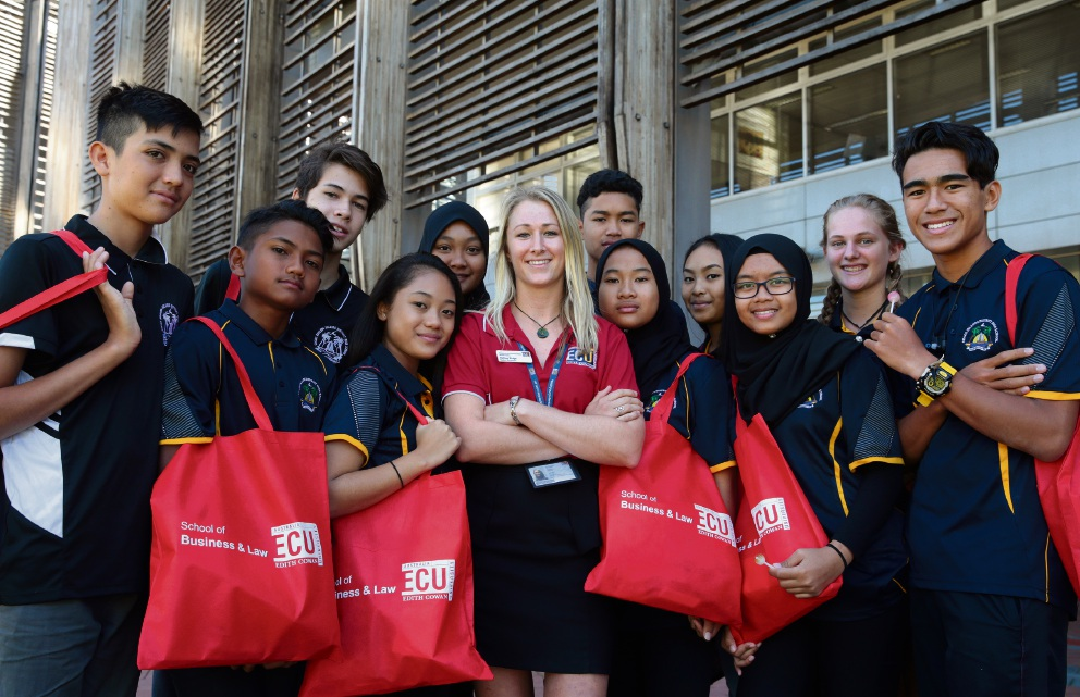Student recreation co-ordinatorAshley Ridge with the Cocos Island DHS students.  Picture: Martin Kennealey  d467303