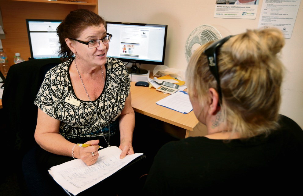 Financial Counsellor Taryn Benn from Midlas talks to local resident Natasha. Picture: David Baylis