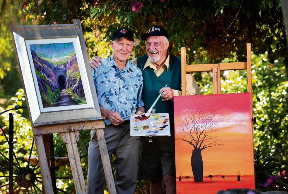Tom Hogg of Maida Vale and Harry Barden of Stratton, getting ready for the Art in the Garden exhibition at the Romancing the Stone gardens in Maida Vale. Picture: David Baylis
