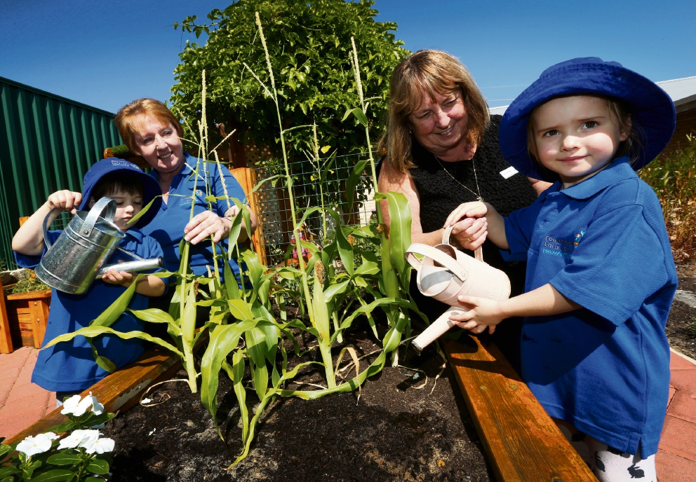 Educational leader Maria Dose and director Caroline Cleary with children Hunter Rose and Thea Williams in their new garden. Picture: Matt Jelonek         d467688