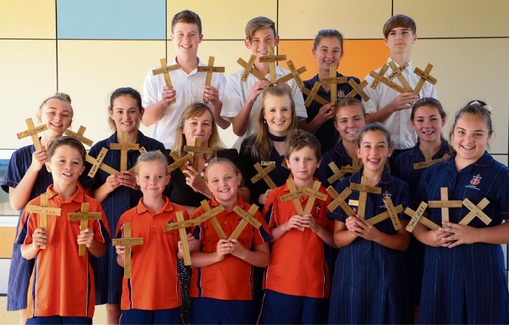 Students from St James Anglican School in Alkimos have made these crosses to be laid on the graves of Australian and Papua New Guinean soldiers in a Port Moresby graveyard. Picture: Martin Kennealey           d467237