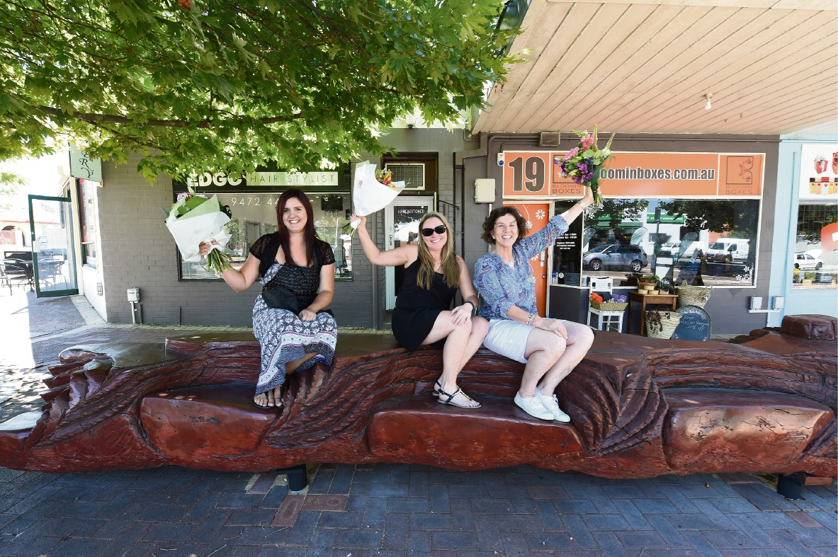 Mel Austen, Kylie Brown and Margaret Pritchard try out the new sculpture. Picture: Jon Hewson  d463976