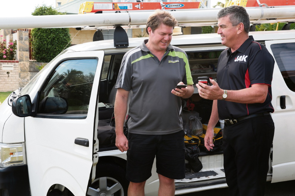 Electrician Dean Wheildon (XP Electrical) with Trevor Pugh (Ocean Reef) co-founder and CEO of Jak app. Picture: Martin Kennealey