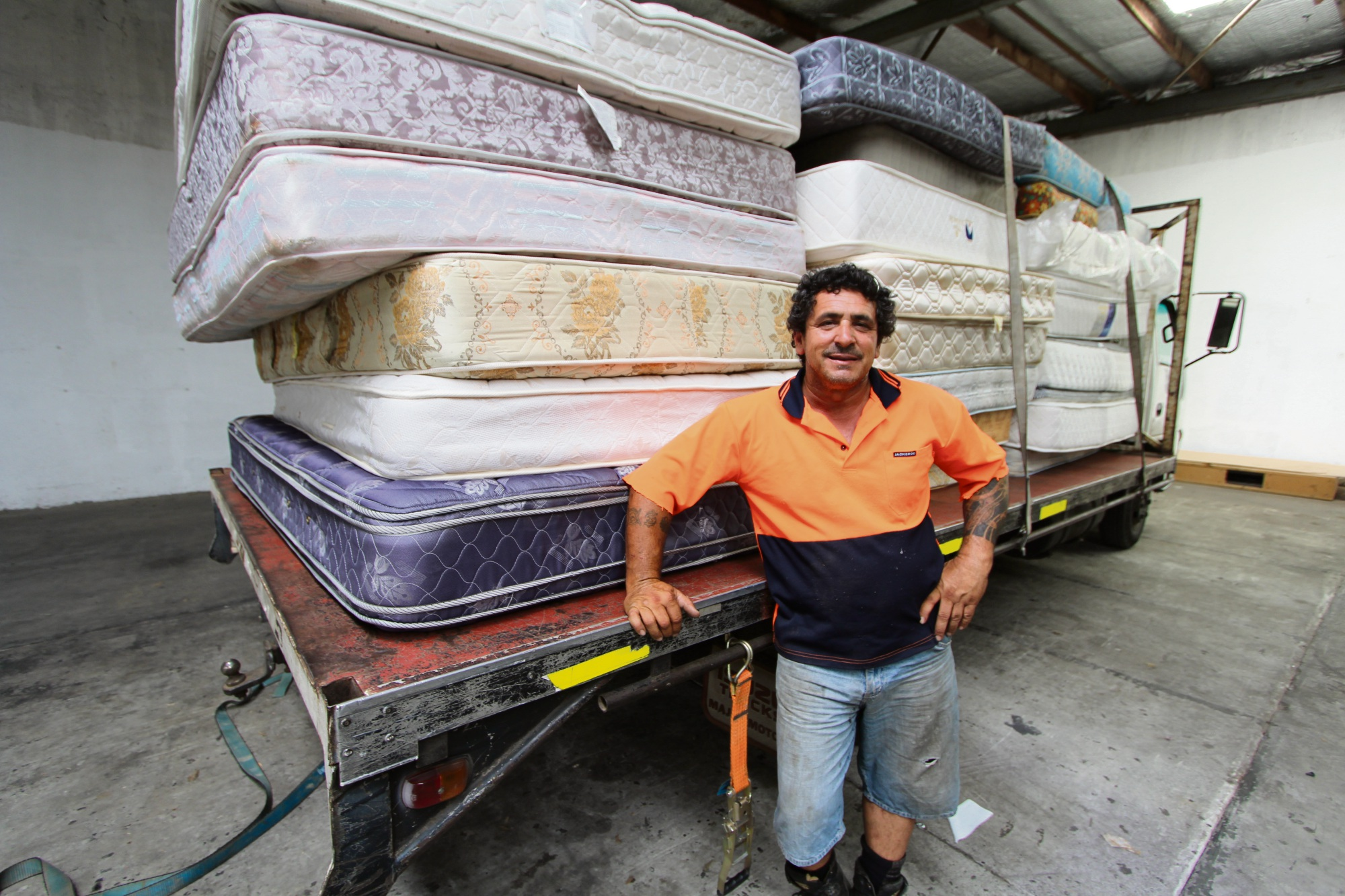 Spider Waste owner Rob Santoro with some of the repurposed mattresses to be sent to remote WA. Picture: Supplied