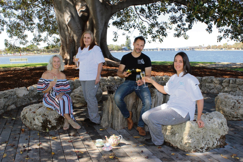 Dee Donegan, Jenny Todd, Peter Mcappion of Cape Bouvard Wines and Natarlie Woodman celebrate the forthcoming high tea beneath the Moreton Bay fig.