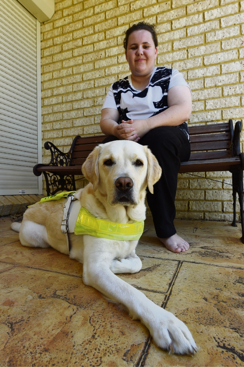 Ayesha Patterson with her guide dog Beirdie. Picture: Jon Hewson