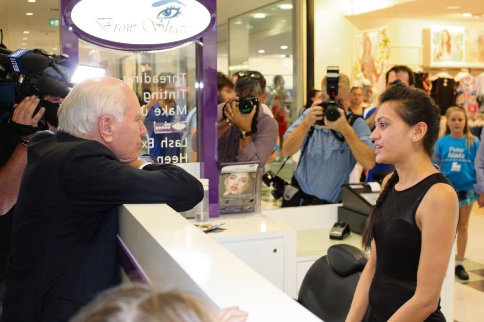 Former Prime Minister John Howard with Brow Shape store owner Sarika Gevaria.