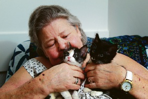 SwanCare resident Cathy Lau with kittens Nalah and Harry. Picture: Marie Nirme