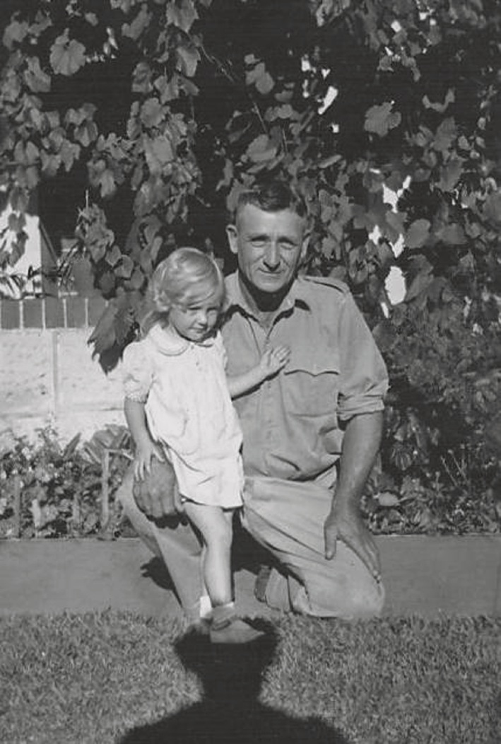 Nerina Coopes, then aged two, with her father.