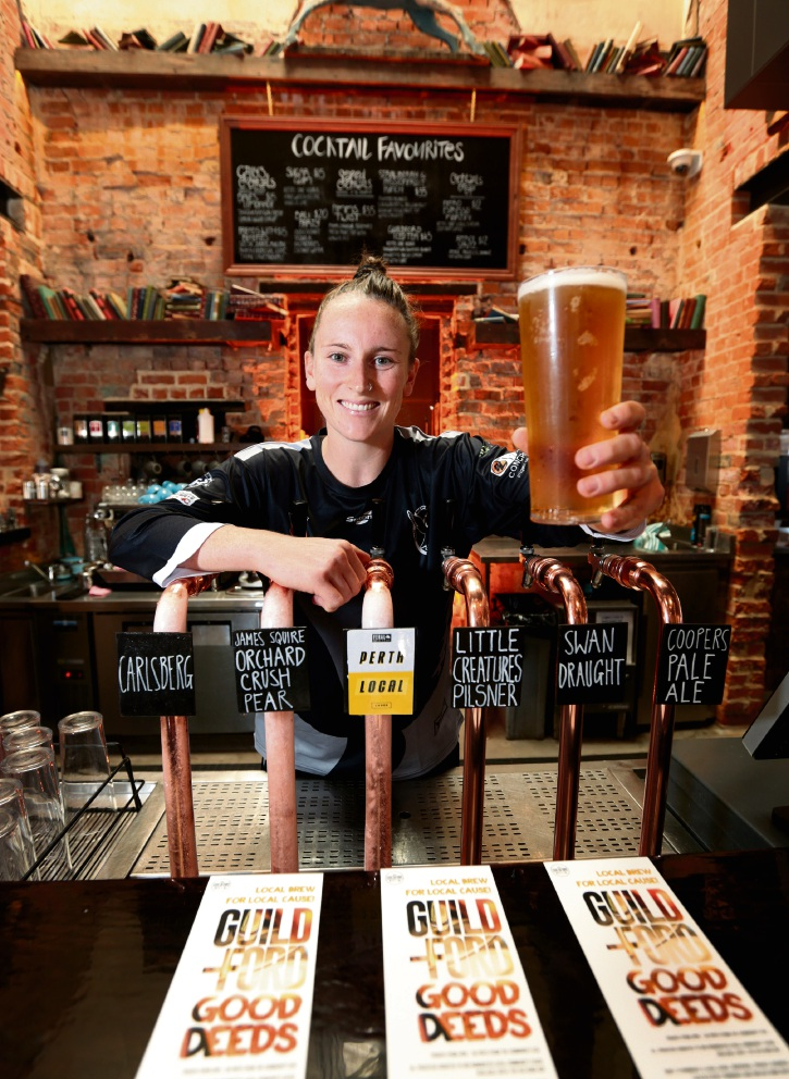Swan Districts Football Club Women's Team captain Kara Donnellan with a pint at The Guildford Hotel to help promote the new Charity Pint concept. Picture: David Baylis