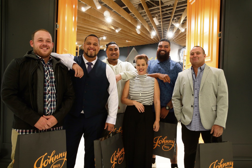 Johnny Bigg by Tarocash manager Michelle Vocisano with Joondalup Giants rugby players Sam Norton, Prince Fuimaono, Yvan Fidow-Kele, Junior Suifili and David Huber.