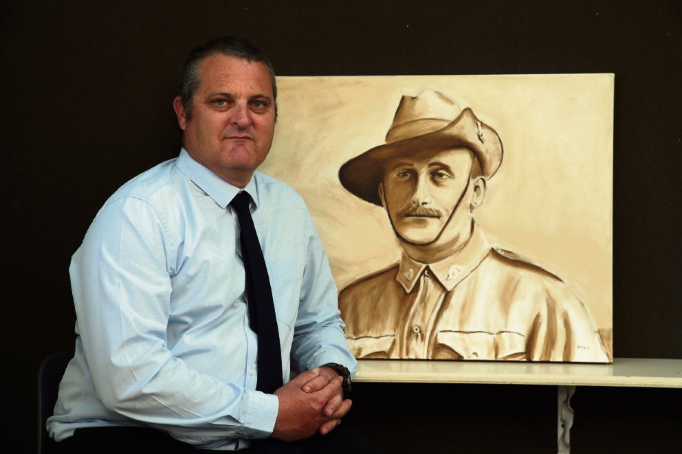 Brad Kay with a portrait of his great grandfather Kenneth Kay. Picture: Martin Kennealey        www.communitypix.com.au   d468072