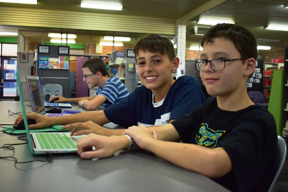 Riley Gooch (11, near), Kai Taylor (13, centre) and Richard Pountney (13, far) enjoying some coding fun.
