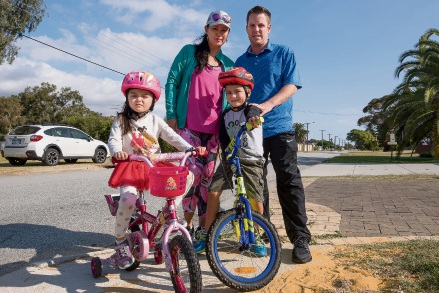 Mason ward councillor Jesse Jacobs with his partner Sherry Sun and their children Gabriel Jacobs (6) and Chelsea Jacobs (4) on Crawford Street - one of many streets in East Cannington in need of a footpath.