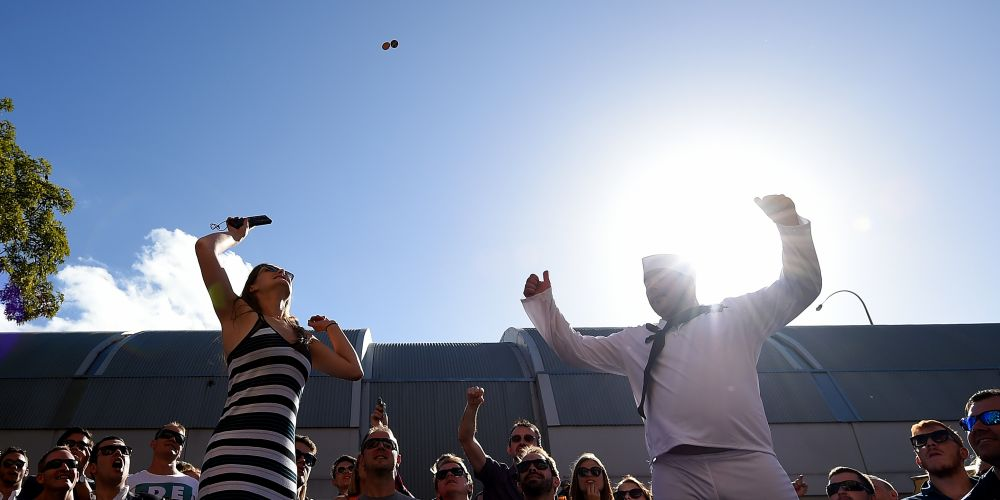 patrons take part in a traditional game of Two-Up on Anzac Day, at the Australian Hotel in Sydney, Monday, April 25, 2016. This year marks the 100th anniversary of the first Anzac Day service. (AAP Image/Dan Himbrechts) NO ARCHIVING