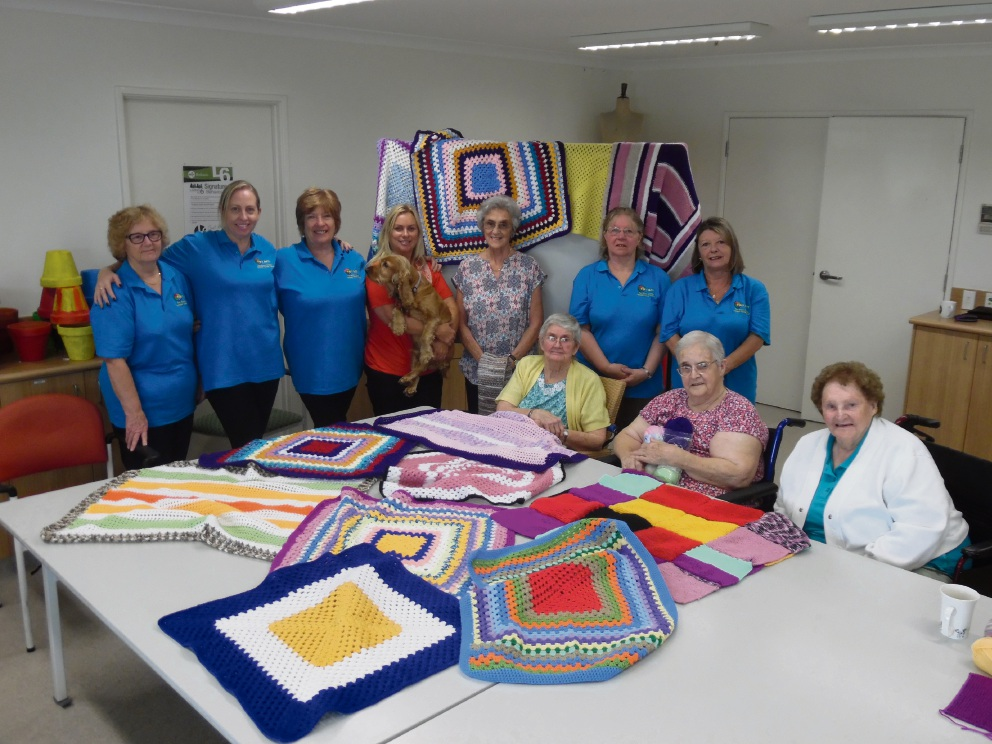 Members of Bethanie Beachside art and craft group donated crocheted knee rugs to the Two Rocks Yanchep Assisted Cancer Travels group.