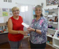 Rockingham Arts and Crafts Association president Jacqi Beaumont hands over a cheque to SOUL's Patty Powell.