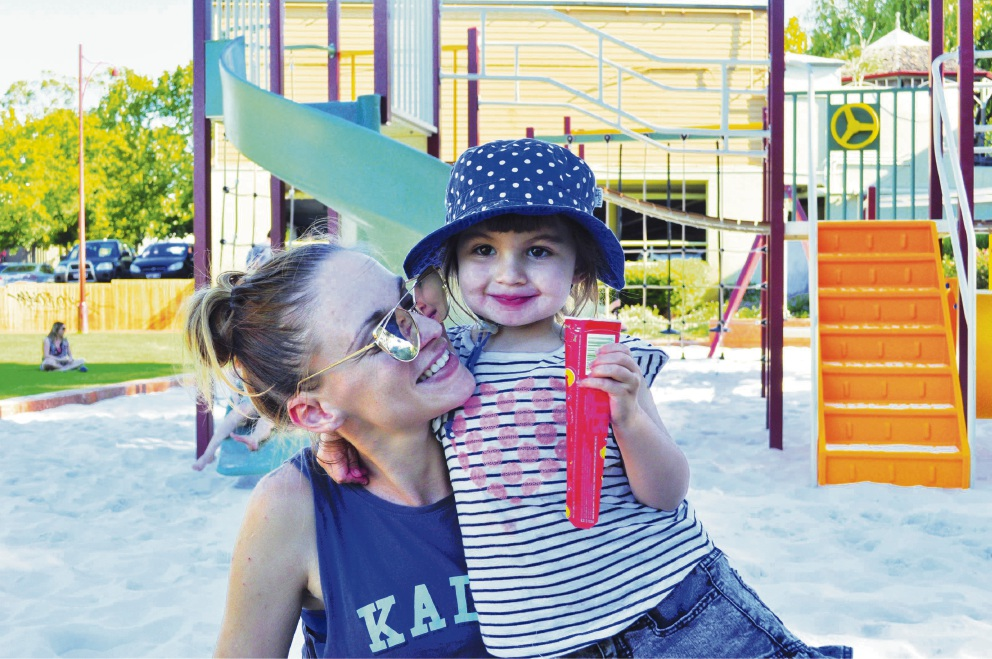 Kaye Waterhouse and her three-year-old daughter Elodie try out playtime in the new Lions Pioneer Park.