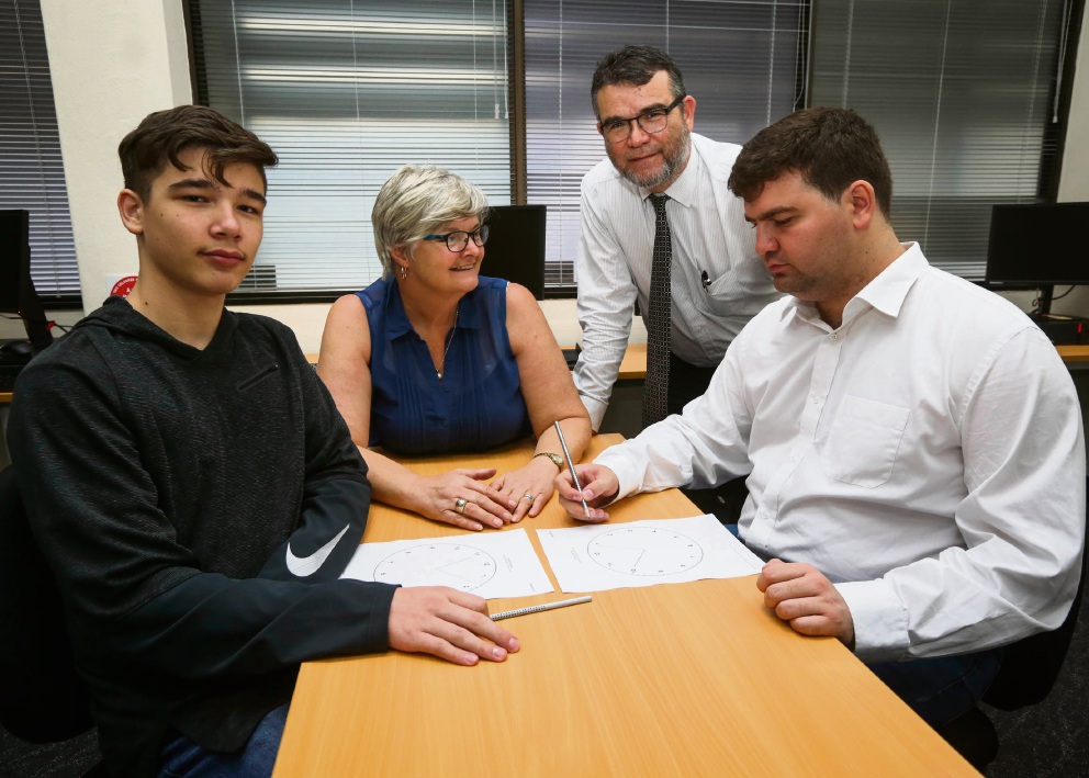 Student Daniel Harlock with teacher Joanne Dickenson, student Ishmael Harlock and father John Harlock. Picture: Matt Jelonek