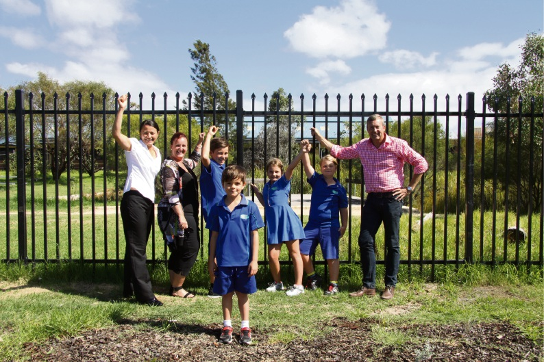 Overlooking the site of the Bertram Nature Playground are Bertram P& C secretary Jodie Papiccio, president Jo Greasley, students Daniel Papiccio, Cameron Papiccio, Tahlia and Jack Greasley and Labor candidate Reece Whitby.