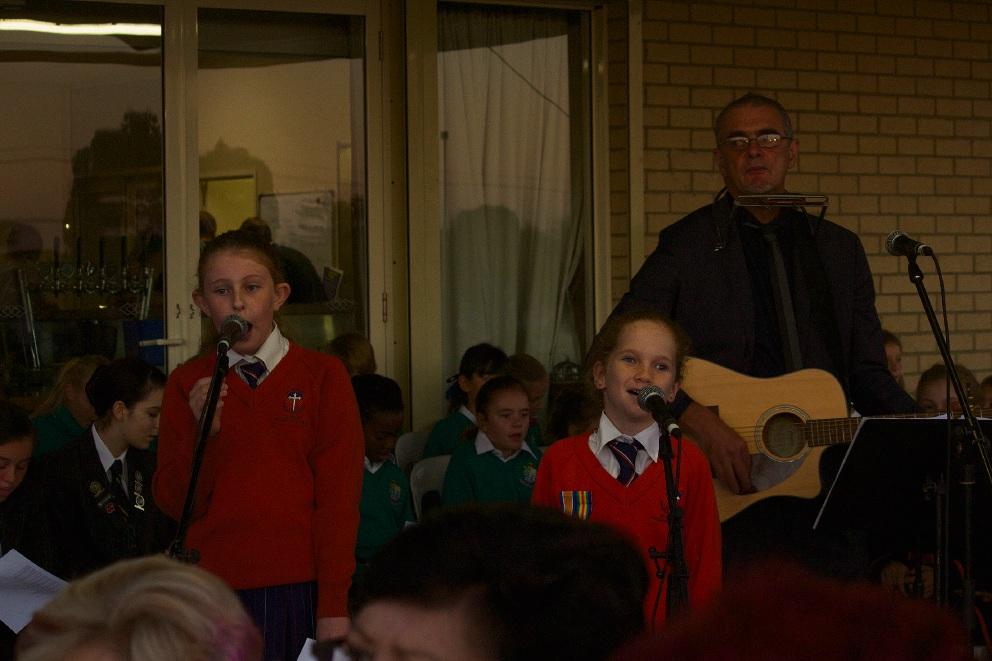 Anzac Community Choir singing Waltzing Matilda.