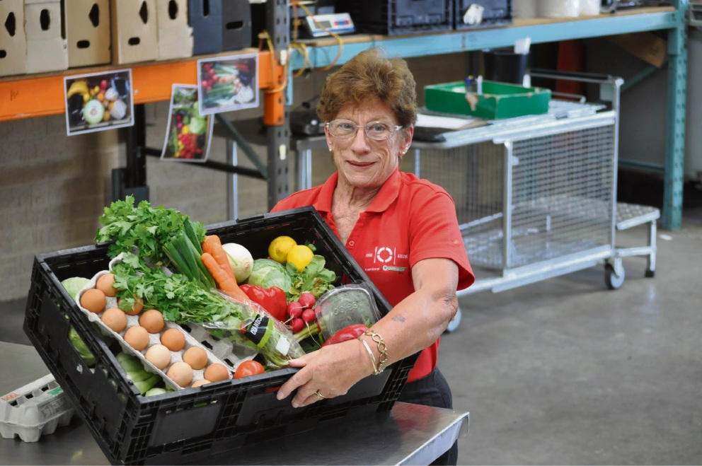 Lil Donald loves volunteering at Food Rescue because she knows she is helping the less fortunate.