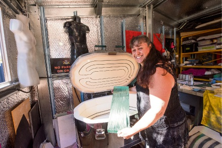 Donna Lydon with one of her glass wave creations. Picture: Emma Geary