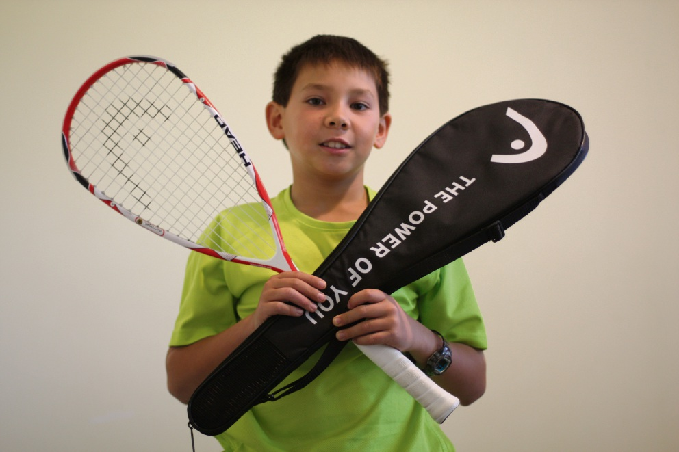 Division 5 winner Daniel Marsh shows off his new racquet.