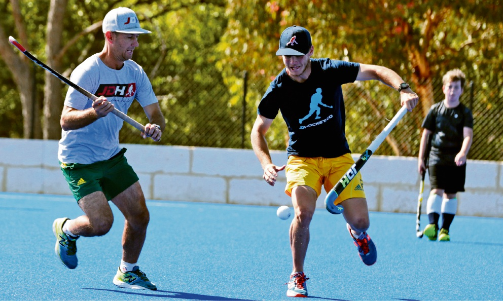 Former Kookaburra player (left) Jamie Dwyer running a clinic. Picture: Martin Kennealey d468045