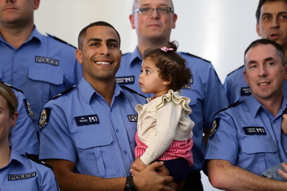 Abubakr Ali with daughter Ameena and other graduates. Picture: Martin Kennealey www.communitypix.com.au   d468632