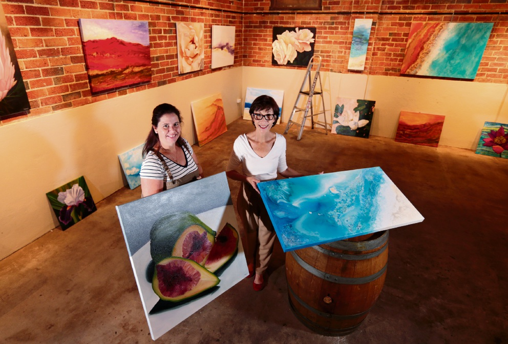Hayley Kruger of Ellenbrook and Jackie Peach of Queens Park, getting ready for their Pure Colour exhibition at Houghton Winery. Picture: David Baylis  www.communitypix.com.au d468467