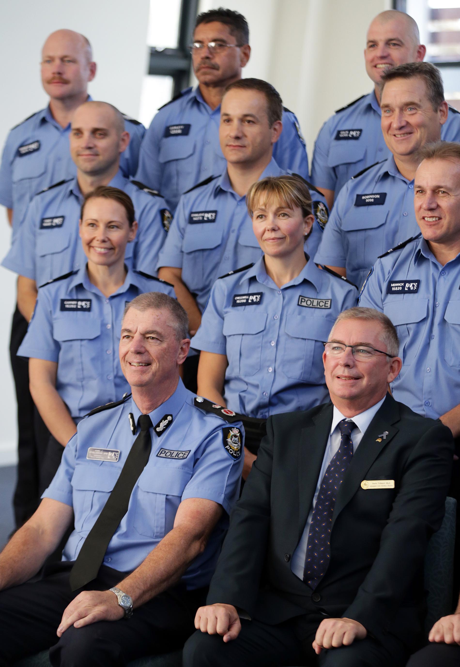 Police Commissioner Karl O'Callaghan and Burns Beach MLA Mark Folkhard with graduates.