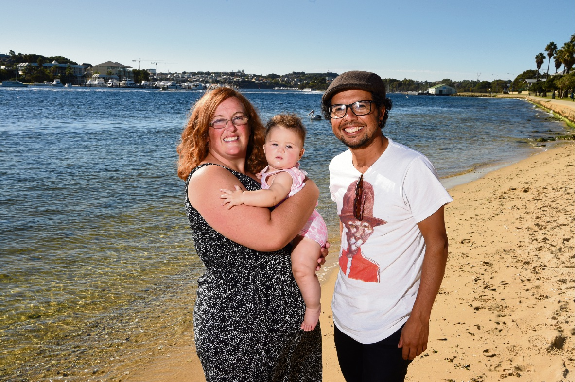 Leah Rucks with Amelia Lopez (six months) and Edgar Gonzalez. Picture: Jon Hewson