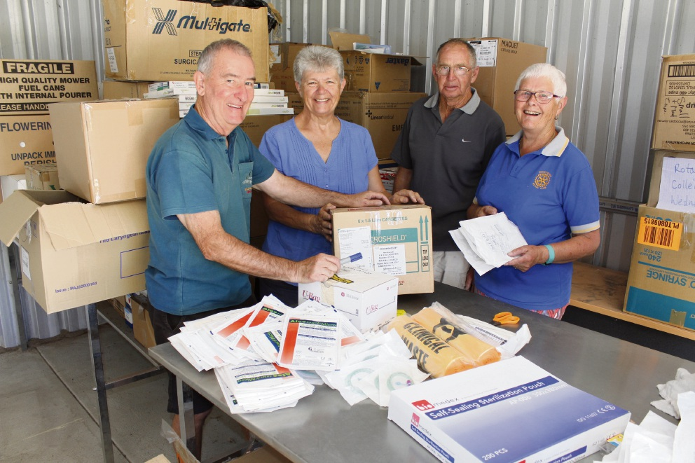 Harry and Jacqui Smith and Peter and Beth Phillips sort out medical supplies to be shipped to East Timor.