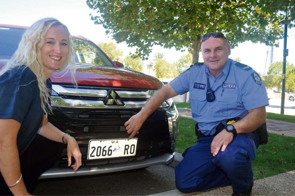 City of Rockingham Community Development Officer Jo Draper inspects the anti-theft number plate screws on a City vehicle with First Class Constable Eddie Cuthbert.