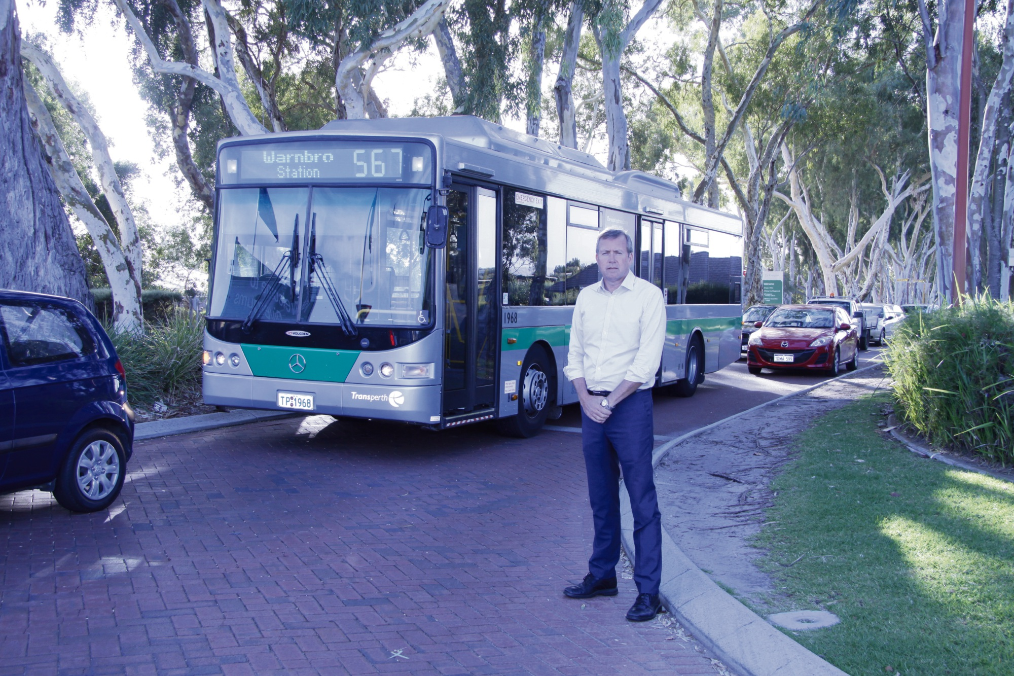 Reece Whitby with traffic congestion behind him at Rivergums Boulevard and Baldivis Road intersection.