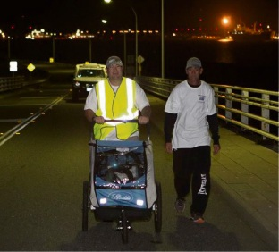 Tristan Harris crosses the HMAS Stirling causeway at the start of his Legacy charity walk across Australia.