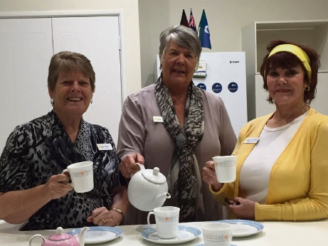 Volunteers Shirley Lloyd, Bronwyn Jones and June Wilson get ready for the high tea.