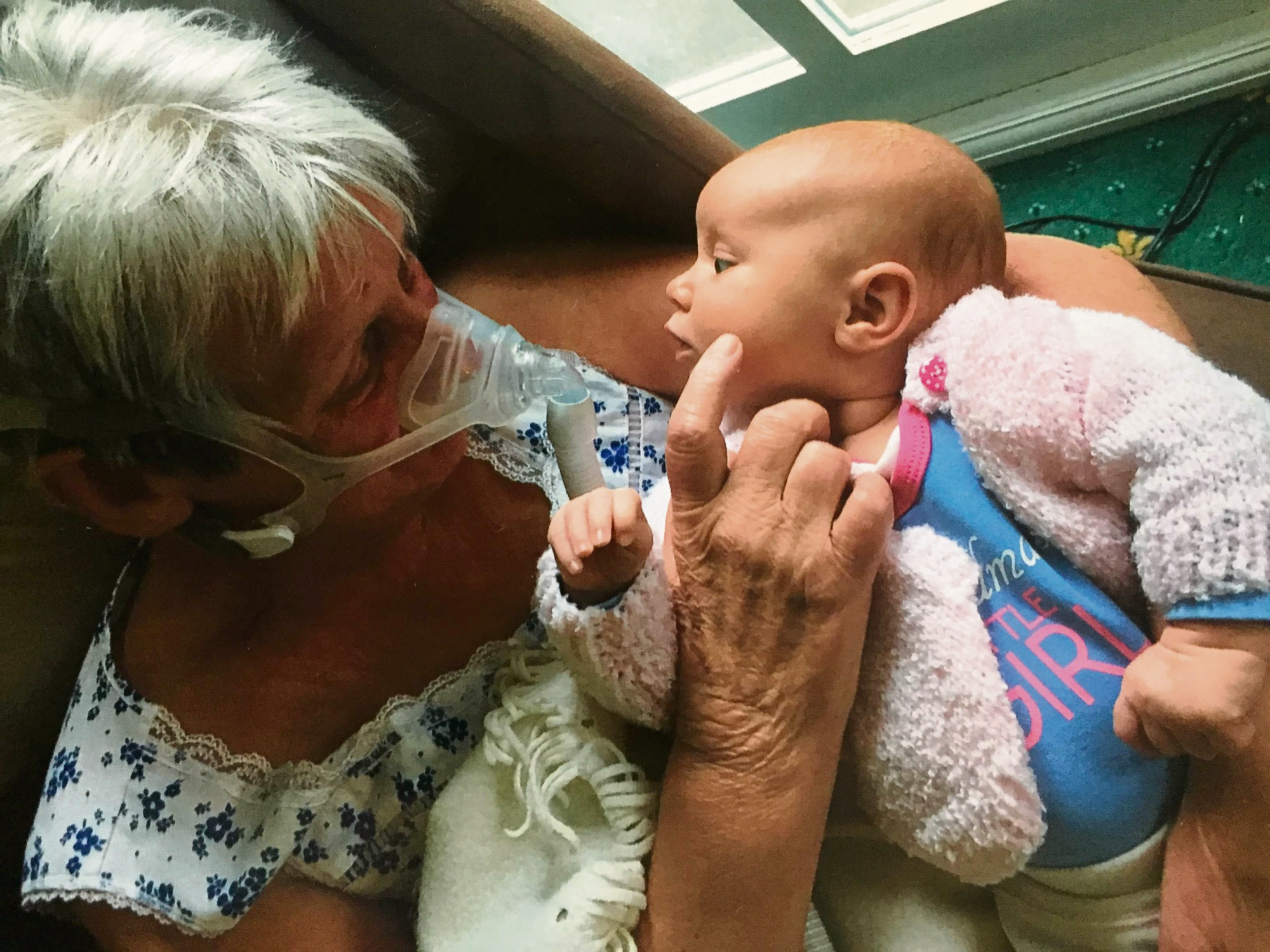 Anne Milburn meets granddaughter Ella for the first time.
