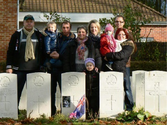 Thomas Richard Barlow's grave in Belgium, with carers of the gravesite, the Desmarets family.