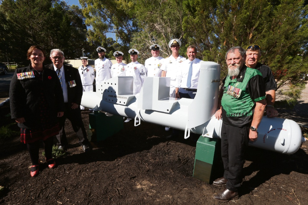Brand MHR Madeleine King, Laurie Drage, submariners from HMAS Stirling, Captain Brian Delamont, Baldivis MLA Reece Whitby and Les Crowe at the official of the replica mini-submarine.