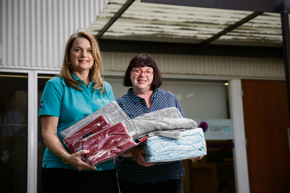 GIVIT's state manager Anna Presser and Breast Cancer Care WA's Natalie Lewis with some of the goods being donated. Picture: Andrew Ritchie