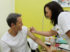 Josh Wilson receives his annual flu vaccination from Banovich Pharmacy's Michelle Banovich.