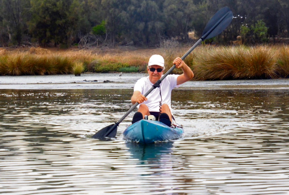 Remco van Santen paddles on the Swan River.
