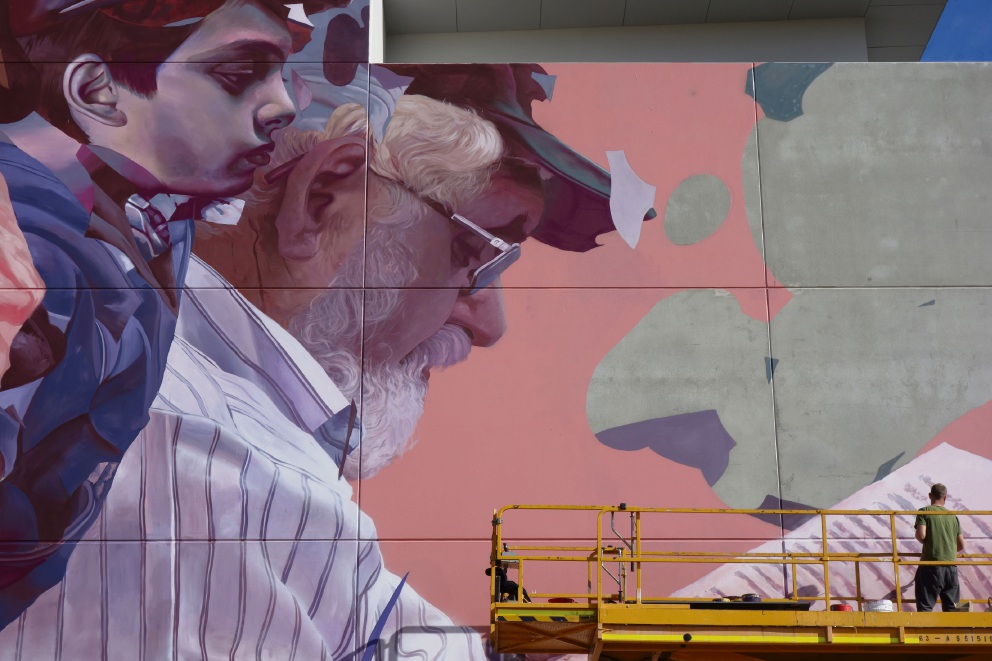 Artistic duo Telmo Miel work on the mural.